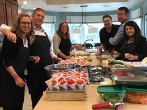 Volunteers prepare meal